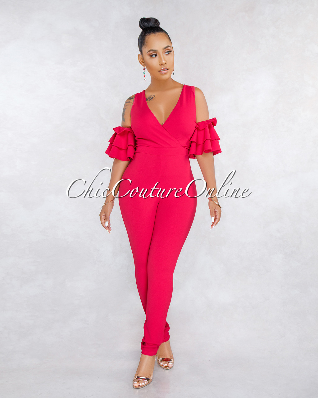 26067c9d73a3 Simile Fuchsia Ruffle Cold Shoulder Jumpsuit. Price   60.00. Image 1