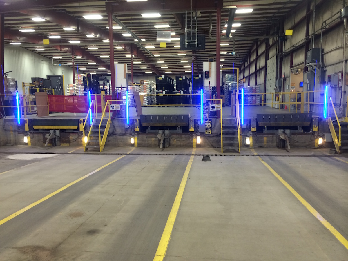 truck allignment in shipping dock bay lighting