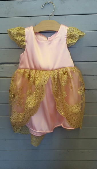This beautiful dress will make your little one feel just like a little princess. It is made out of pink satin and has gold lace overtop. This dress is very delicate and could be used on many different occasions.