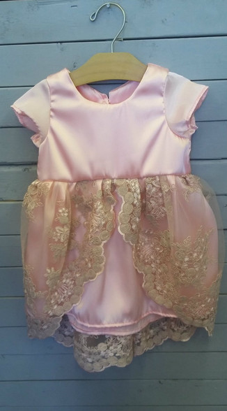 """This Virginia, also know as the """"Princess Dress"""" is so elegant and beautiful. The dress is made out of pink satin and has pink lace overtop. It is perfect for many occasions, or even just making your little one feel like a princess."""