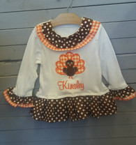 This adorable Turkey shirt is so perfect for fall and Thanksgiving. The dress can be personalized with your choice of name or initials. The ruffles just add on to the cuteness!