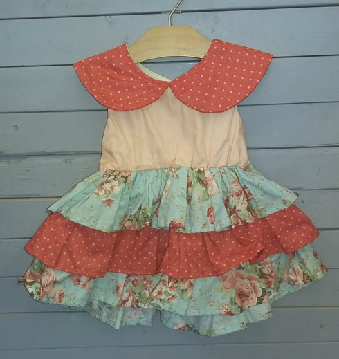 This beautiful vintage looking dress is so perfect! It is a very unique style with its combination of flowers and polka dots. It can be worn for many different occasions. It even has a teacup party look to it.