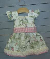 This gorgeous dress is very vintage and unique. The pink and white checkered waistband really brings out some things in the background. This dress is made with excellent quality.