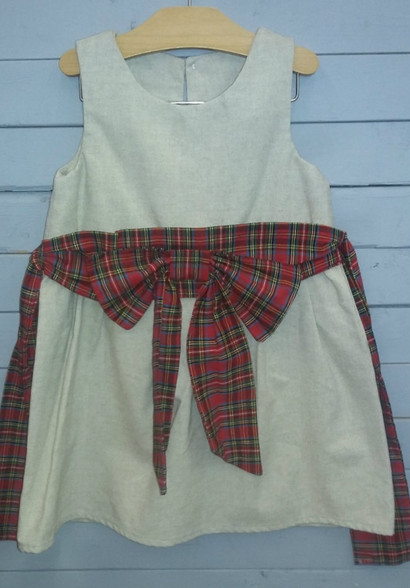 This dress is perfect for the holidays that are coming up. Cream is very, very popular this year!! The cream dress goes so good with the plaid waistband and bow on front. This dress can easily have a long sleeve shirt of your choice slid underneath for the cool weather.