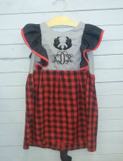 This beautiful dress is perfect for the holidays, or even just regular casual days! It is made to be customized with your choice of initials, font, and font color. The antlers that are appliqued give this dress a cabin look. The buffalo plaid on the bottom of the dress is a very big style this year. The gray and black on the top half of the dress assist on bringing the dress together as a whole.