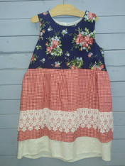 This gorgeous dress is perfect for just about any occasion!! It has a sort of vintage look and the colors all work so well together. This dress can be worn year round. Super easy to slide a long sleeve shirt of choice underneath. Would even look cute with leggings underneath. So many different ways to wear this stylish dress!