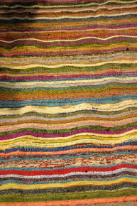Handmade Small Rug is woven from recycled sari silk  At Tibet Spirit Store,