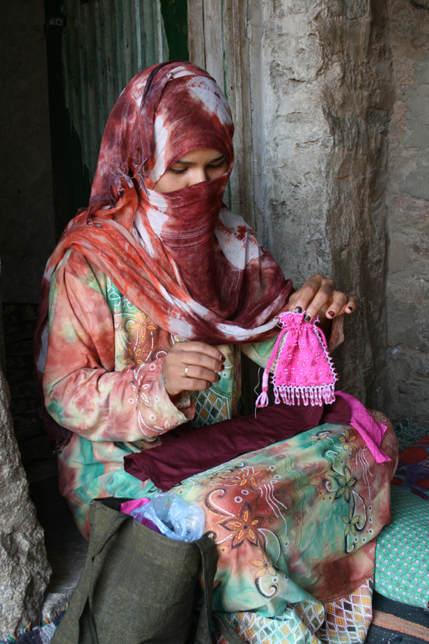 woman-embroidering-pink-pouch.jpg
