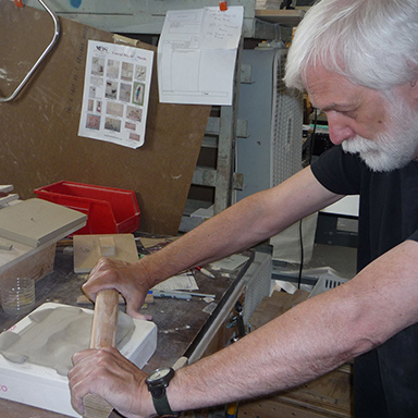 Medicine Bluff Studio's John Beasley Pressing a handmade arts and Crafts STyle tile