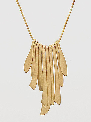long metal organic shaped pendant necklace, worn gold