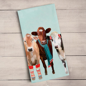 festive cow club tea towel