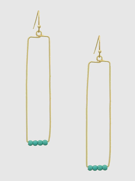 worn gold turquoise earrings
