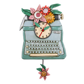 "Clock, typewriter, retro, whimsical,  measures 14″ x 8″, hand-painted leaf hands, swinging flower pendulum,  cast in resin, finished by hand,  requires ""AA"" battery, designed by artist Michelle Allen"