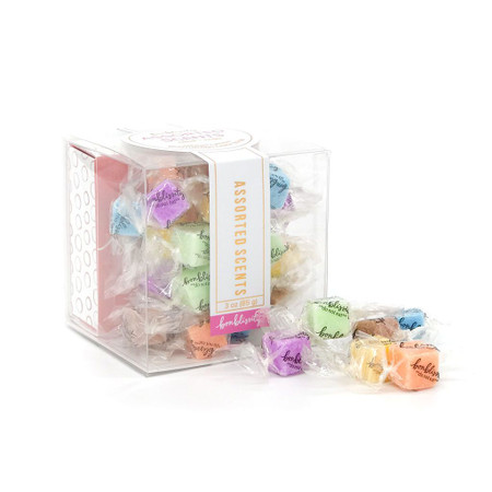 Candy-wrapped solid scrubs, massage, 3-in-1 lotion, silky soft skin, exfoliate, biodegradable cellulose helps, each box contains 30 and  a mini travel box.