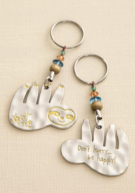 Keychain, sloth, don't hurry be happy, double-sided, bead embellishment. Composition: 100% zinc alloy Dimensions: 2.75in L x 1.8in W