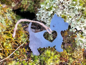 west highland terrier with heart ornament