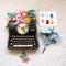 black type writer pendulum clock