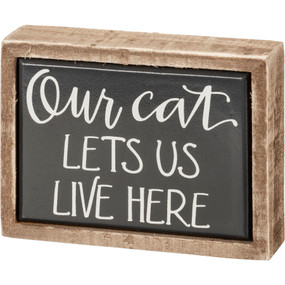 our cat lets us live here box sign