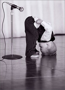 boy bending microphone birthday