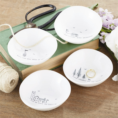 These small trinket bowls are each made of porcelain and feature a sweet phrase on them! By Twos Company.