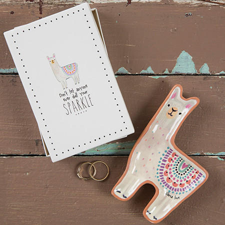 """This Santa Fe Trinket Dish is so fun and giftable! It's a cute llama shape with a hand-designed print and comes in a simple and ready-to-wrap white box with the sweet sentiment, """"llama love"""" ... perfect for gifting to your favorite llama loving friends and family! Shaped trinket dish with sweet sentiment. Comes in a box for easy gifting!  terra cotta Box - 3.375in L x 5.25in W x .5in H, Dish - 3.25in L x 5.125in W x .5in H"""