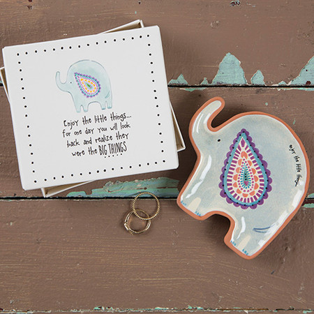 "This Santa Fe Trinket Dish is so fun and giftable! It's a cute elephant shape with a hand-designed print and comes in a simple and ready-to-wrap white box with the sweet sentiment, ""enjoy the little things"" ... perfect for gifting to your favorite elephant loving friends and family! Shaped trinket dish with sweet sentiment. Comes in a box for easy gifting!  Terra cotta Box - 4.375in L x 4in W x .5in, Dish - 4in L x 3.75in W x .5in H"