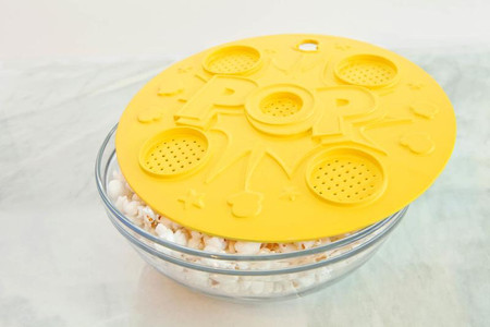 """10"""" lid for microwaving fresh, healthy popcorn Control how much butter is used Butter vents slowly melt the butter/flavoring as popcorn pops Use with any size microwave-safe bowl Great for microwaving vegetables, too! BPA-free, FDA-approved silicone Dishwasher and microwave safe"""