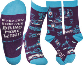"Colorfully printed socks lending a bottom ""If You Can Read This Bring More Wine"" sentiment with varying wine, cheese, and grape designs.  Cotton, nylon, spandex.  One size fits most."