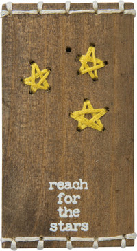 "A wooden block lending a distressed ""Reach For The Stars"" sentiment with hand-stitched star accents and top and bottom stitched ladder border details. Contains strong back magnet or can free-stand alone."