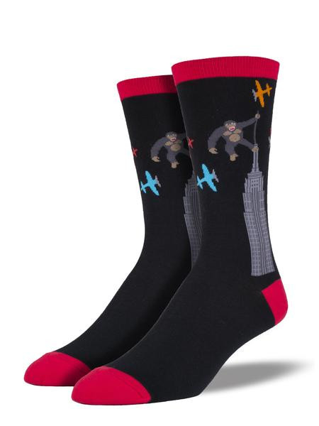 Beat your chest and be a man with these men's Kong socks. This giant ape is swinging at airplanes from the top of the Empire State Building, and is sure to add some fun to your wardrobe!   Sock size 10-13 fits U.S. men's shoe size 7-12.5 Fiber Content: 70% Cotton, 27% Nylon, 3% Spandex