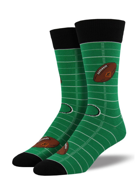 Your outfit will never be a fumble with these football socks! Available in green and featuring a football field and flying footballs, these socks are sure to be the best compliment to your Monday Night Football outfit.   Sock size 10-13 fits U.S. men's shoe size 7-12.5 Fiber Content: 70% Cotton, 27% Nylon, 3% Spandex