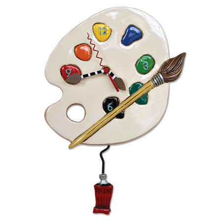 "Art time clock •    measures 13″ x 8.5″ •    hand-painted paint brush hands •    swinging paint tube pendulum •    cast in resin, finished by hand •    requires ""AA"" battery Designed by artist Michelle Allen"