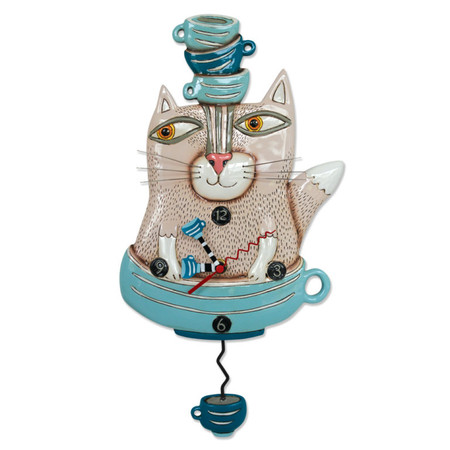 """Tea cat clock This whimsical clock features: •    measures 15.5″ x 8″ •    hand-painted teacup hands •    swinging teacup pendulum •    cast in resin, finished by hand •    requires """"AA"""" battery Designed by artist Michelle Allen"""