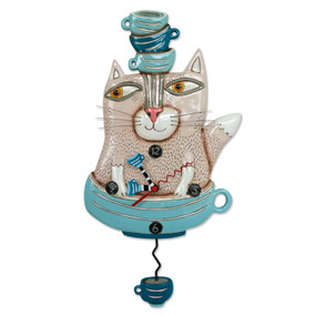 "Tea cat clock This whimsical clock features: •    measures 15.5″ x 8″ •    hand-painted teacup hands •    swinging teacup pendulum •    cast in resin, finished by hand •    requires ""AA"" battery Designed by artist Michelle Allen"