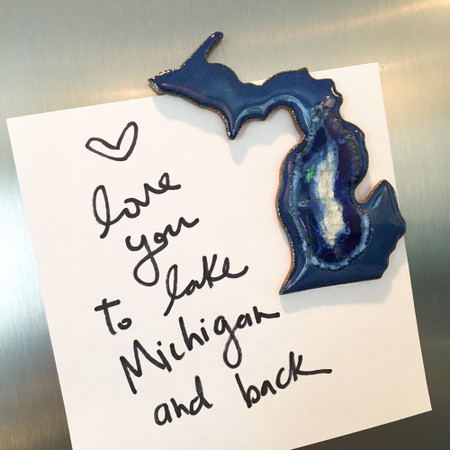 "Bring your love of Michigan to your refrigerator with this stunning handmade magnet.  Resembling the crystalline, geological complexity of geode cross-sections, this stoneware and glass glazed trivet bring handcrafted beauty to functional home decor. The organic interaction of stoneware, glass, and colored glazes produces a unique, crackled surface with fascinating variations that make each magnet one-of-a-kind. Handmade by Kerry Brooks in Minneapolis, Minnesota. Due to the handmade nature of this item, each is unique and will vary.  Size: approximately 2"" x 3"""