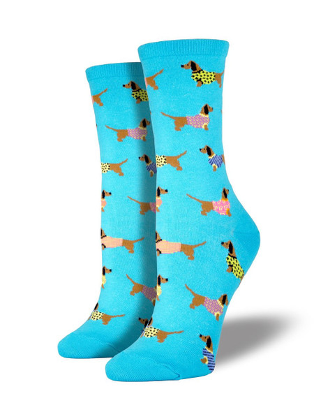 Is there anything cuter than a wiener dog wearing a sweater?... These socks are! Our fashionable dachshund socks are sure to brighten up your sock drawer!   Sock size 9-11 fits U.S. women's shoe size 5-10.5 Fiber Content: 63% Cotton, 34% Nylon, 3% Spandex