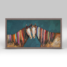 """The tender touch of a cheek make this scene of rainbow maned horses emotional.  Good things come in small packages! And in this case it's our new mini framed canvas art. Get creative by bringing a series of small things together. These mini masterpieces come ready to set on a shelf or hang on a wall. Our frames are approximately 1.25"""" in depth and come with a lightly distressed rustic finish that creates a beautiful texture. Please note that frame color is predetermined for each design and the frame finishes may vary due to the intentional rustic finish. Our canvas art is reproduced in our San Diego studios using the best digital reproduction method currently available, resulting in great clarity and color saturation. Canvases are exceptionally durable and can be cleaned with a soft, dry or slightly damp cloth.    Artist:  Eli Halpin.   Size: 10x5 ."""