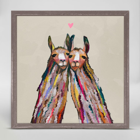 "These little llamas are sweet on each other. Share their joy by hanging this on your wall and you'll smile every time glance this pair's way. Good things come in small packages! And in this case it's our new mini framed canvas art. Get creative by bringing a series of small things together. These mini masterpieces come ready to set on a shelf or hang on a wall. Our frames are approximately 1.25"" in depth and come with a lightly distressed rustic finish that creates a beautiful texture. Please note that frame color is predetermined for each design and the frame finishes may vary due to the intentional rustic finish. Our canvas art is reproduced in our San Diego studios using the best digital reproduction method currently available, resulting in great clarity and color saturation. Canvases are exceptionally durable and can be cleaned with a soft, dry or slightly damp cloth.  Artist:  Eli Halpin   Size:   6x6"