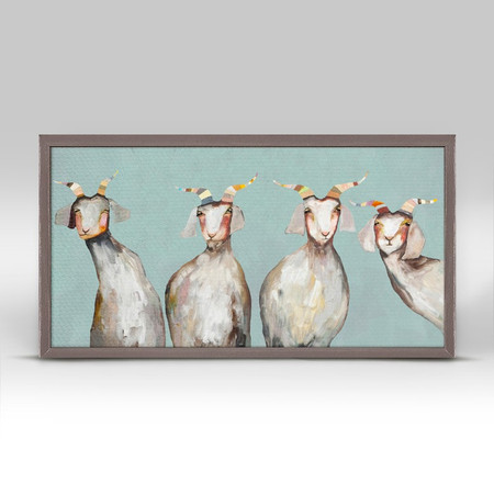 """Say hello to four friendly goats in this mini canvas art with a soft blue background. Good things come in small packages! And in this case it's our new mini framed canvas art. Get creative by bringing a series of small things together. These mini masterpieces come ready to set on a shelf or hang on a wall. Our frames are approximately 1.25"""" in depth and come with a lightly distressed rustic finish that creates a beautiful texture. Please note that frame color is predetermined for each design and the frame finishes may vary due to the intentional rustic finish. Our canvas art is reproduced in our San Diego studios using the best digital reproduction method currently available, resulting in great clarity and color saturation. Canvases are exceptionally durable and can be cleaned with a soft, dry or slightly damp cloth.  Artist:  Eli Halpin   Size:  10x5"""