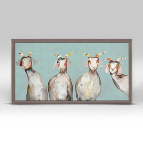 "Say hello to four friendly goats in this mini canvas art with a soft blue background. Good things come in small packages! And in this case it's our new mini framed canvas art. Get creative by bringing a series of small things together. These mini masterpieces come ready to set on a shelf or hang on a wall. Our frames are approximately 1.25"" in depth and come with a lightly distressed rustic finish that creates a beautiful texture. Please note that frame color is predetermined for each design and the frame finishes may vary due to the intentional rustic finish. Our canvas art is reproduced in our San Diego studios using the best digital reproduction method currently available, resulting in great clarity and color saturation. Canvases are exceptionally durable and can be cleaned with a soft, dry or slightly damp cloth.  Artist:  Eli Halpin   Size:  10x5"
