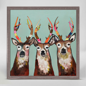 "These hip deer are true attention grabbers. Finished in our rustic natural frame, this mini art piece is perfect on your shelf or wall. Collect a group of mini canvases by artist Eli Halpin for an art collage everyone will love! Good things come in small packages! And in this case it's our new mini framed canvas art. Get creative by bringing a series of small things together. These mini masterpieces come ready to set on a shelf or hang on a wall. Our frames are approximately 1.25"" in depth and come with a lightly distressed rustic finish that creates a beautiful texture. Please note that frame color is predetermined for each design and the frame finishes may vary due to the intentional rustic finish. Our canvas art is reproduced in our San Diego studios using the best digital reproduction method currently available, resulting in great clarity and color saturation. Canvases are exceptionally durable and can be cleaned with a soft, dry or slightly damp cloth.  Artist:  Eli Halpin   Size:  6x6"