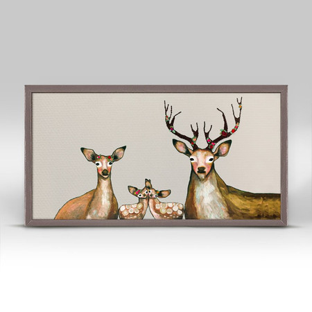 """This lovely family is looking at you, in a most endearing way. Eli Halpin's deer artwork cozies up a neutral interior and adds an element of surprise and originality. Good things come in small packages! And in this case it's our new mini framed canvas art. Get creative by bringing a series of small things together. These mini masterpieces come ready to set on a shelf or hang on a wall. Our frames are approximately 1.25"""" in depth and come with a lightly distressed rustic finish that creates a beautiful texture. Please note that frame color is predetermined for each design and the frame finishes may vary due to the intentional rustic finish. Our canvas art is reproduced in our San Diego studios using the best digital reproduction method currently available, resulting in great clarity and color saturation. Canvases are exceptionally durable and can be cleaned with a soft, dry or slightly damp cloth.  Artist:  Eli Halpin   Size: 10x5"""