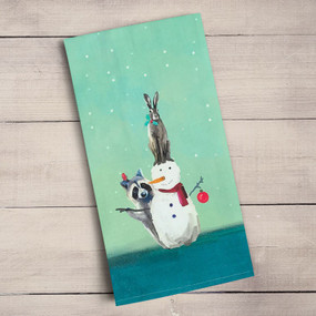 We can't resist the cuteness of these holiday friends building a snowman on a snowy winter day
