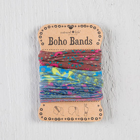 Set of 3. Bands can be worn as a pony holder, headband, or bracelet. Composition: 100% polyester. Dimensions: 20 in around.