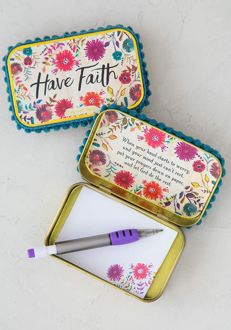 Gold tin box, paper notes, and a mechanical pencil inside. Enough notes for 50 prayers. Sentiment: have faith Composition: tin box, paper, plastic Dimensions: 3.75in L x 2.36in W x 1in H