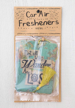 Scent: Ocean Set of 2, features tassel and a wooden bead on an elastic hanger for easy placement. Double-sided, full-color quality printing. Sentiment: Not all who wander are lost Composition: pressed paper with essential oils. exclusive of trim. Dimensions: Approximately 3.5 in diameter