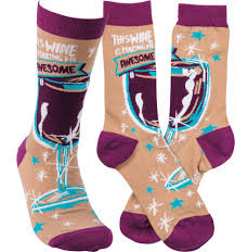 "Colorfully printed socks lending ""This Wine Is Making Me Awesome"" sentiment with sparkly wine glass design. Cotton, nylon, spandex. One size fits most."