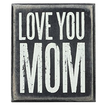 "A classic black and white wooden box sign featuring a distressed ""Love You Mom"" sentiment. Easy to hang or can free-stand alone.   Size: 3"" x 3.50"" x 1.75"""