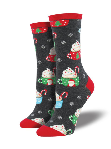 Keep yourself in warm and comfy thoughts when you wear our cocoa Christmas socks. Snowfall and shorter days are no match for this creamy, delicious treat. With Santa and Christmas tree mugs, whipped cream and candy cane stir sticks, these cute socks bring Christmas cheer!   Sock size 9-11 fits U.S. women's shoe size 5-10.5 Fiber Content: 63% Cotton, 34% Nylon, 3% Spandex