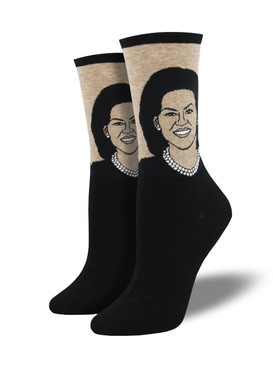This First Lady is greatly loved, so naturally we designed these Michelle Obama socks in her honor. Improved diet, exercise, and a focus on women's empowerment across the globe are only a few of the themes we think of when we roll on these First Lady socks.  Sock size 9-11 fits U.S. women's shoe size 5-10.5 Fiber Content: 63% Cotton, 34% Nylon, 3% Spandex
